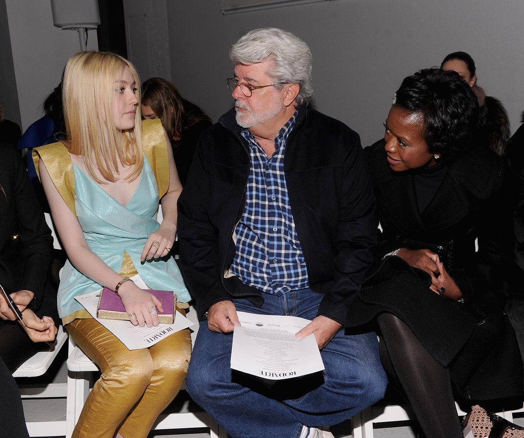 Dakota Fanning and George Lucas during NY Fashion Week.