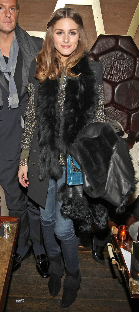 Olivia Palermo added a fur-trimmed layer to her after-hours look at Rachel Roy's post-show fete.