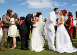 Newlyweds kiss during a mass wedding at the National Croquet Center in West Palm Beach, FL.