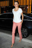 Miranda Kerr wore salmon-colored pants.