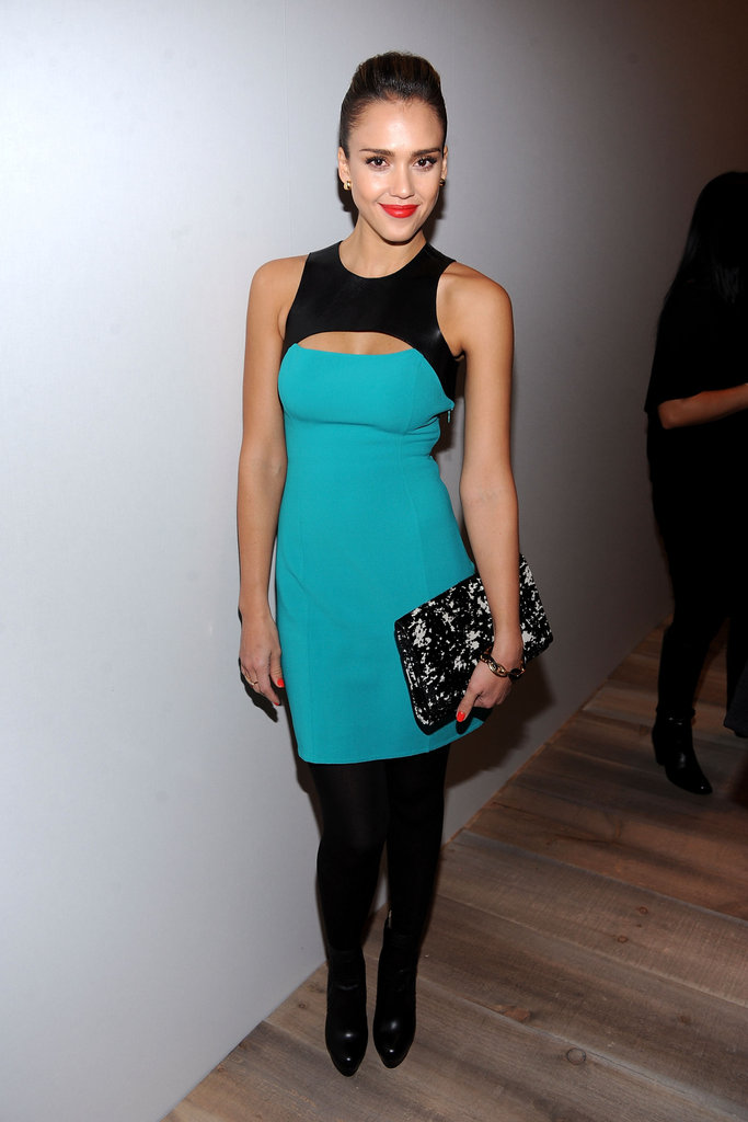 Jessica Alba wore a cutout aqua and black Michael Kors dress to the designer's show.