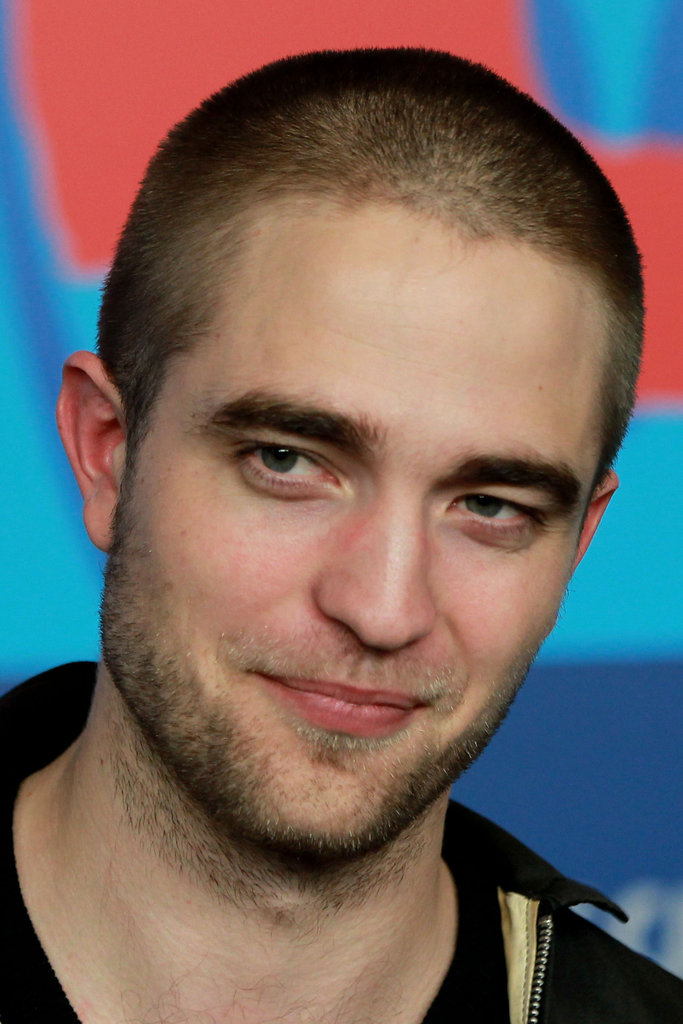 Rob gave a playful smile in Germany at the Bel Ami Press Conference.