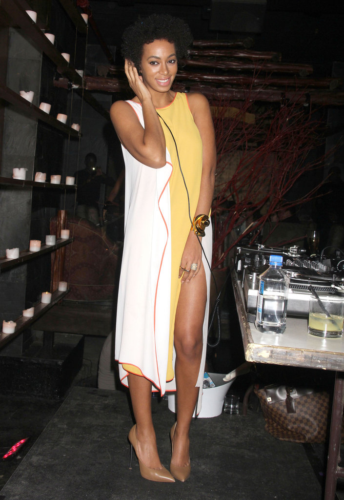 Solange Knowles wore a two-tone white and yellow sheath while DJing during Fashion Week. Her beige pointy-toed pumps are a sleek neutral pairing to the brighter elements on top.