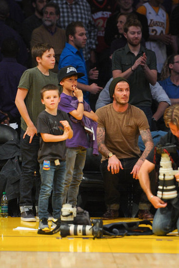 David Beckham, Cruz Beckham, Romeo Beckham, and Brooklyn Beckham watched the Lakers action.