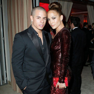 Jennifer Lopez Low-Cut Dress and Casper Smart Pictures at 2012 Vanity Fair Oscars Party