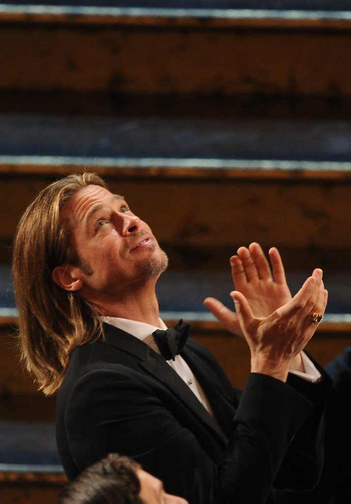 Brad Pitt smiled and applauded while the Muppets were performing.