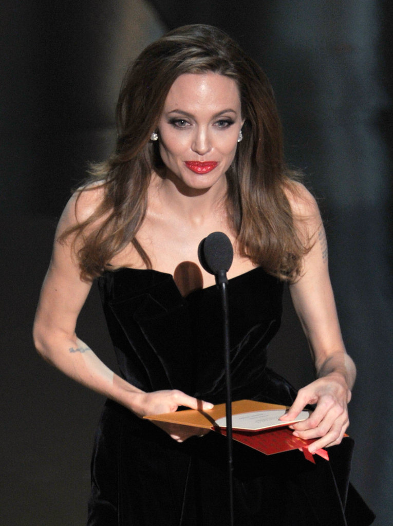 Angelina Jolie presented an award onstage at the 2012 Oscars.