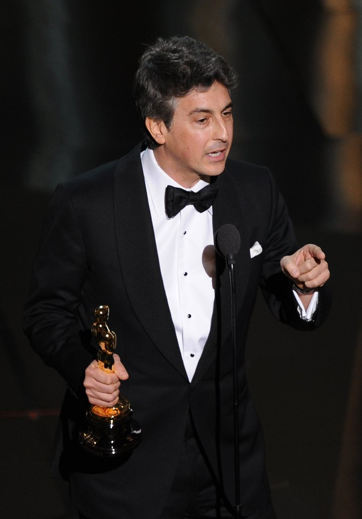 The Descendants director Alexander Payne accepted his Best Adapted Screenplay award onstage at the 2012 Oscars.