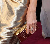 Stacy Keibler's box clutch mirrored the metallic hue of her Marchesa gown.