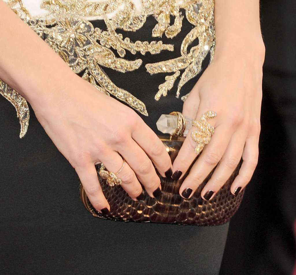 Sandra Bullock's croc-embossed clutch provided a bold contrast to her romantic Marchesa gown.