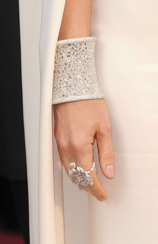 Gwyneth Paltrow added a bold cuff and an oversize cocktail ring to glitz up her streamlined Tom Ford gown.
