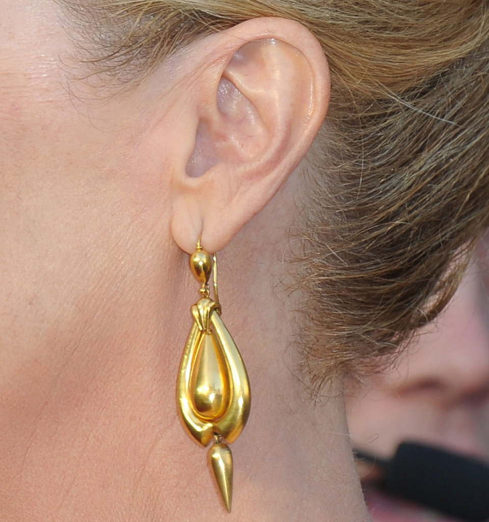 Meryl's gold drop earrings were the finishing touch on a gilded look.