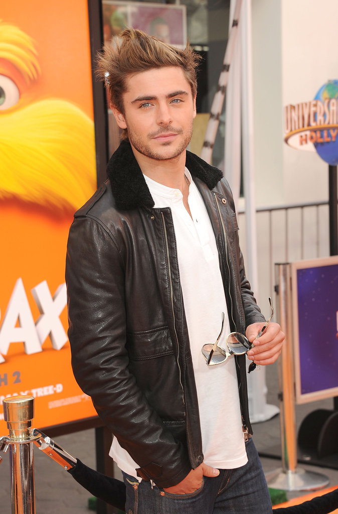 Zac Efron took off his shades to pose for the cameras.