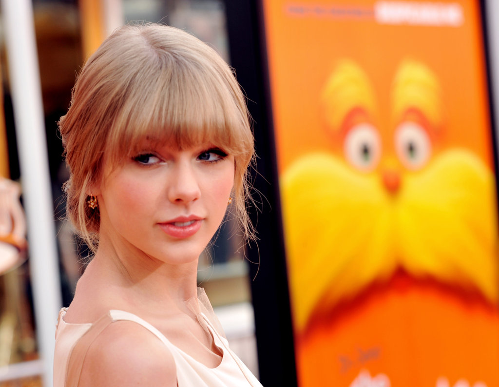 Taylor Swift wore her hair back for the occasion.