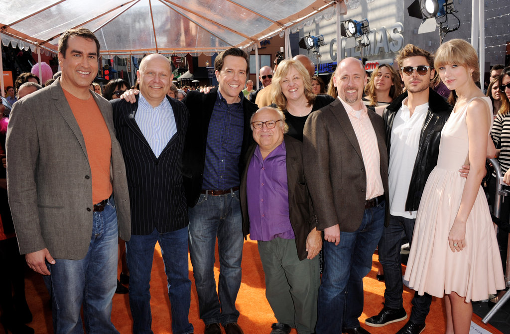 The cast got together for a photo on the orange carpet.