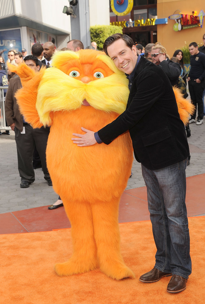 Ed Helms cuddled up to the Lorax.