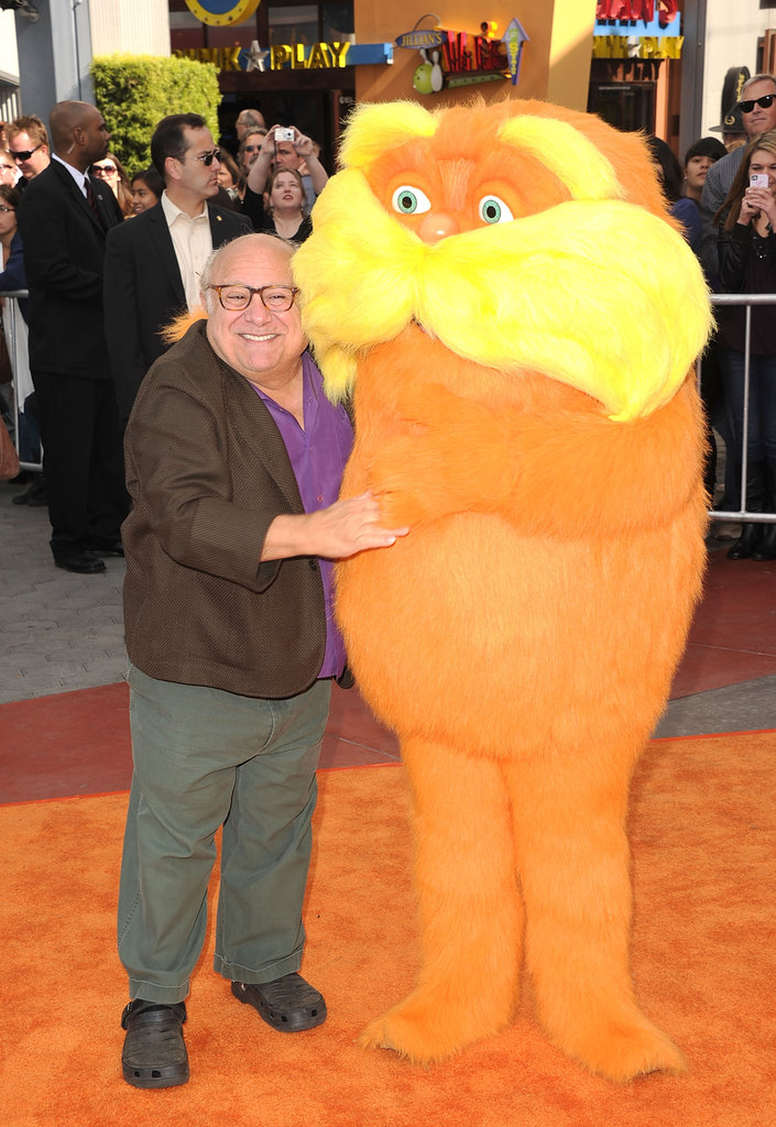 Danny DeVito and the Lorax posed together on the orange carpet.