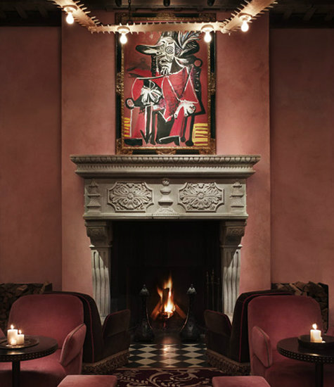 This room embodies the perfect juxtaposition of romantic accents and modern art. Photo courtesy of Gramercy Park Hotel