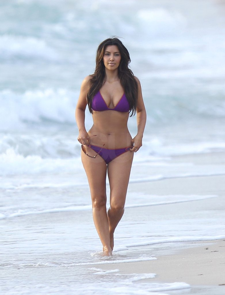 Kim Kardashian walked in the surf while wearing a bikini.