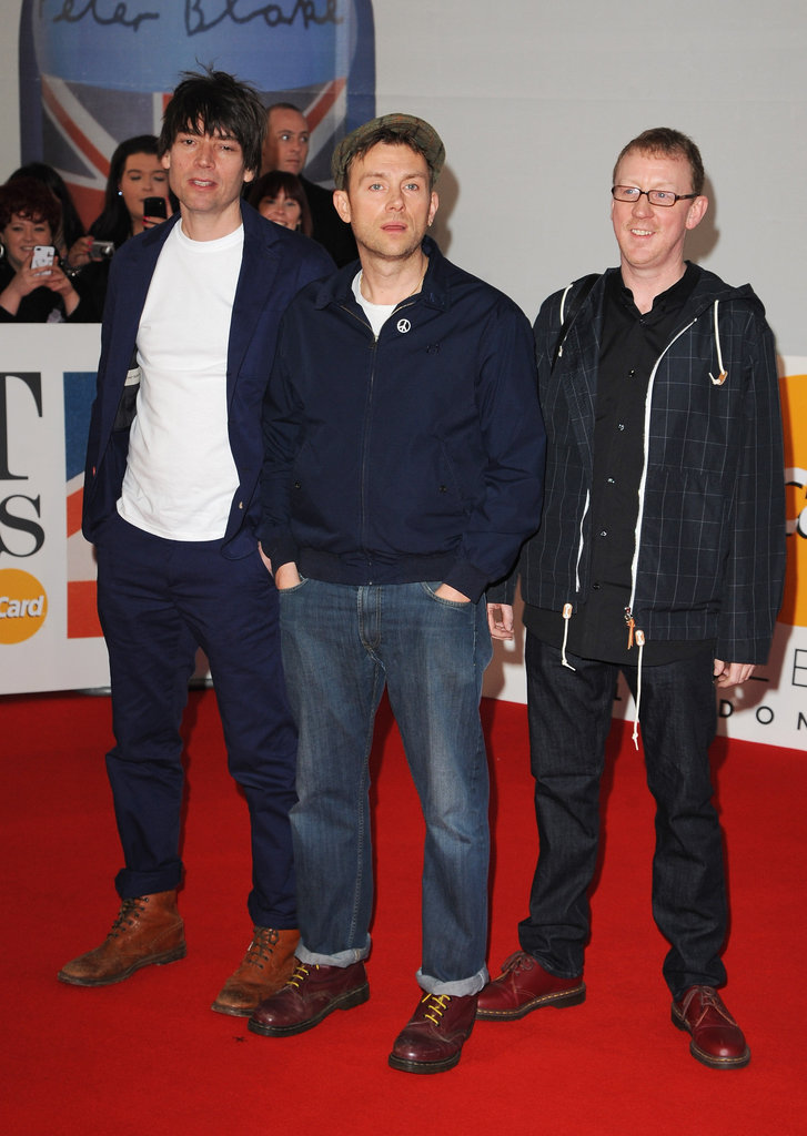 Damon Albarn, Alex James, and Dave Rowntree of Blur were casual on the carpet.