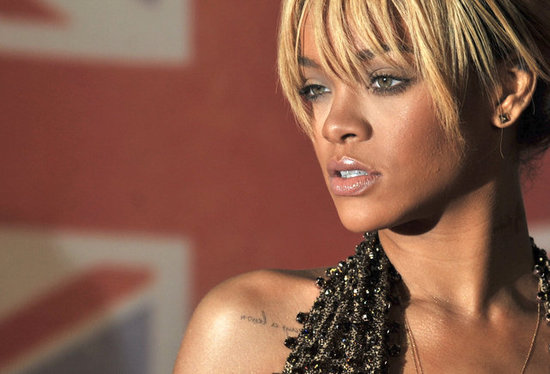Rihanna showed off her collarbone tattoo.