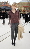 Clemence Poesy donned a sweet polka-dotted blouse with cropped menswear-inspired trousers outside of the Burberry show.