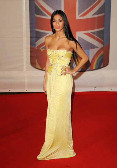 Nicole Scherzinger in yellow Versace.