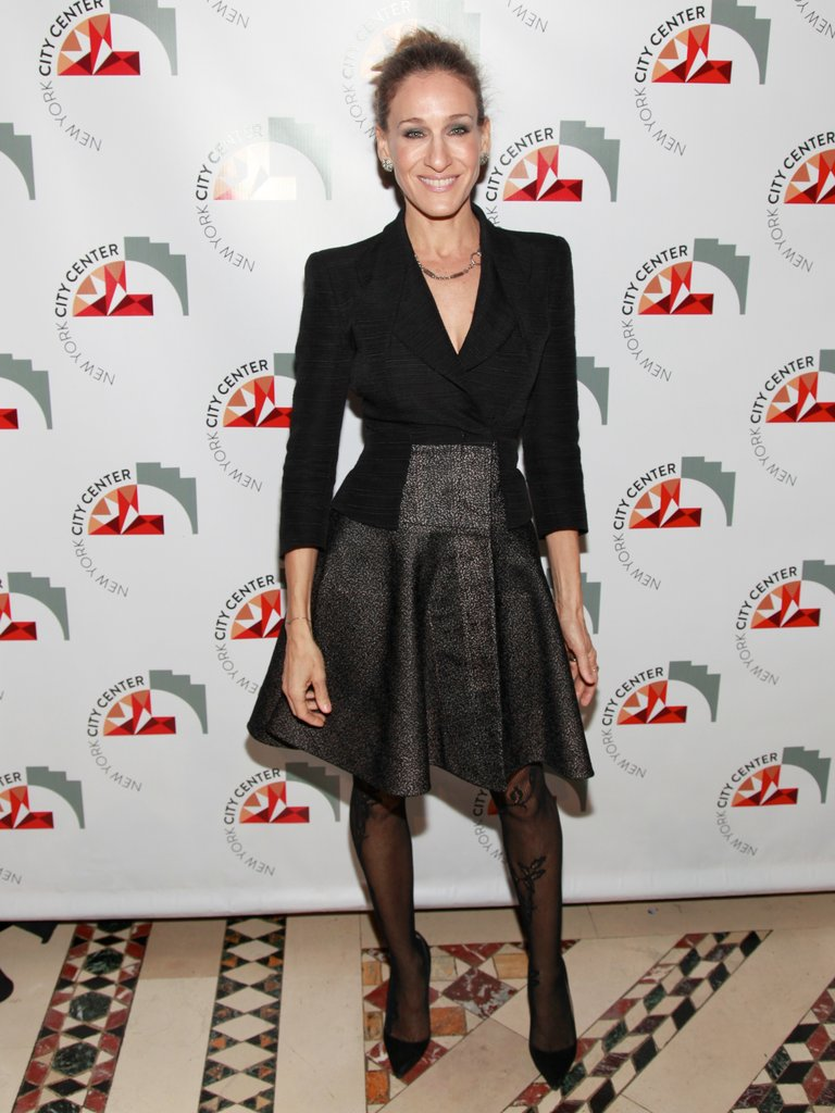 Sarah Jessica Parker gave her full skirt a sharp finish with a bold-shouldered top.