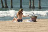 AnnaLynne McCord found a quiet spot on the sand.