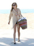 AnnaLynne McCord covered up with a loose cardigan.