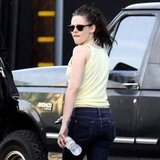 Kristen Stewart in a yellow tank top.