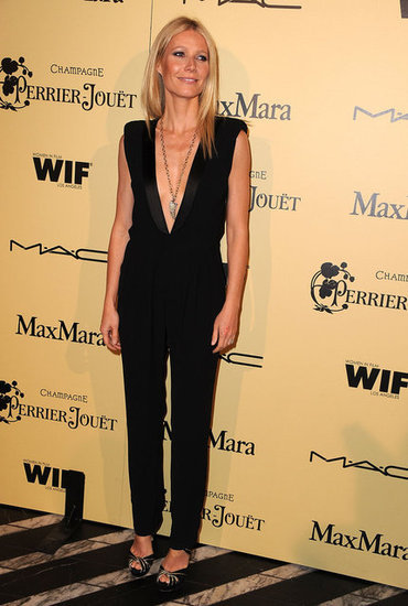 Gwyneth looked stunning in a black Boy. By Band of Outsiders tuxedo-inspired jumpsuit with a plunging neckline. It's the sexiest pants look we've seen in awhile.