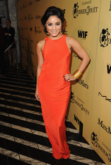 Vanessa Hudgens wore a Tibi orange maxi dress — orange is proving to be a huge color for Spring. She kept her look minimalist with a gold cuff, but indulged in moon-shaped earrings for a boho touch.
