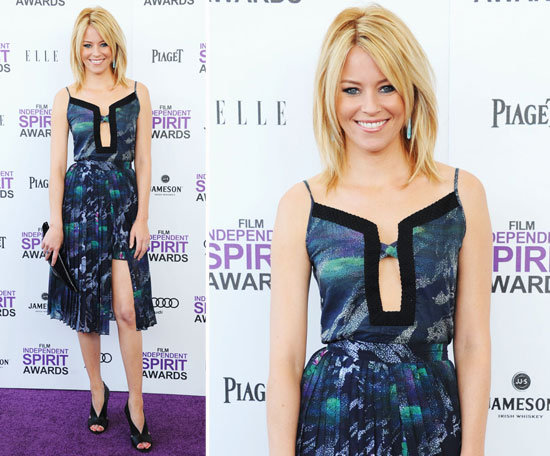Elizabeth Banks wore an asymmetrical-hemmed Timo Weiland creation in a pretty blue graphic print. The cutout front paired with pleated skirt detail made for a super cool mix. She added turquoise drop earrings and a black clutch for the final touches.