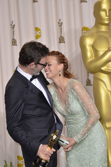 Married couple Michel Hazanavicius and Bérénice Bejo smiled at each other lovingly in the press room in 2012.