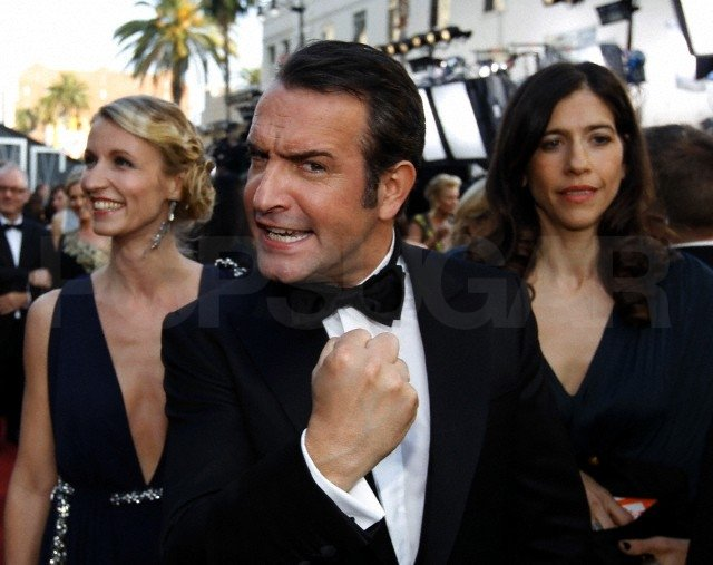 Jean Dujardin was in a winning mood with his blond wife, Alexandra Lamy, by his side.