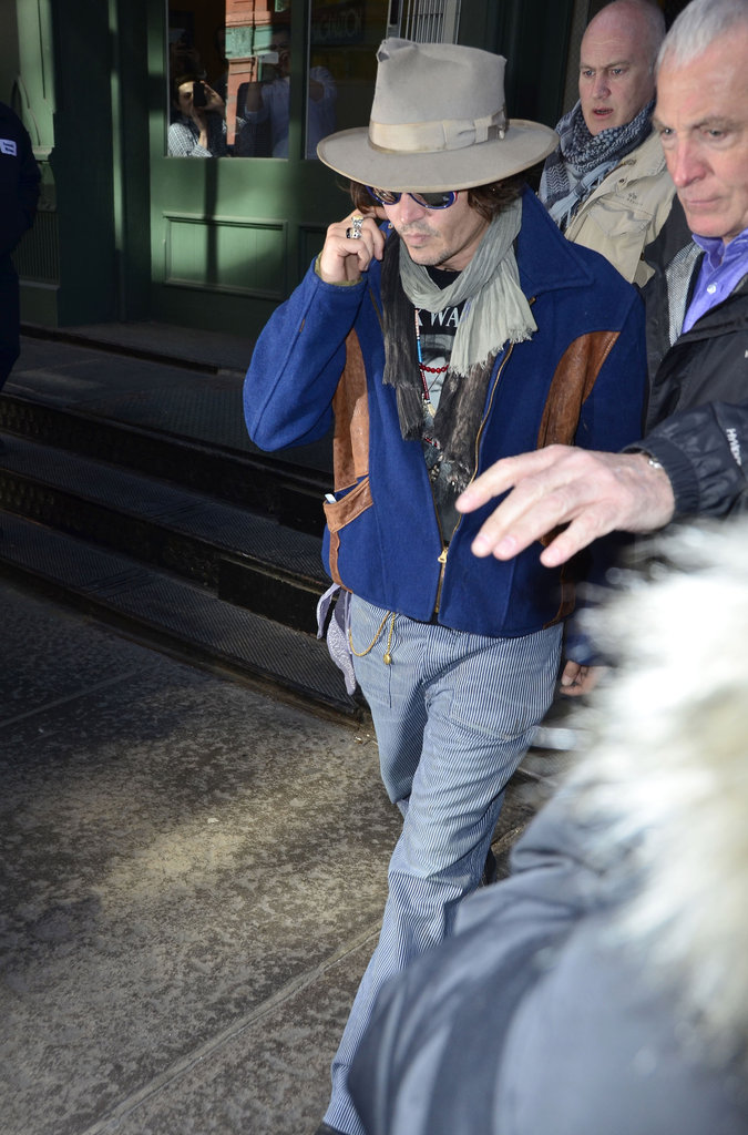 Johnny Depp headed to his car in NYC.