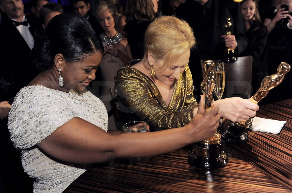 Octavia Spencer and Meryl Streep admired their Oscars together after the show.