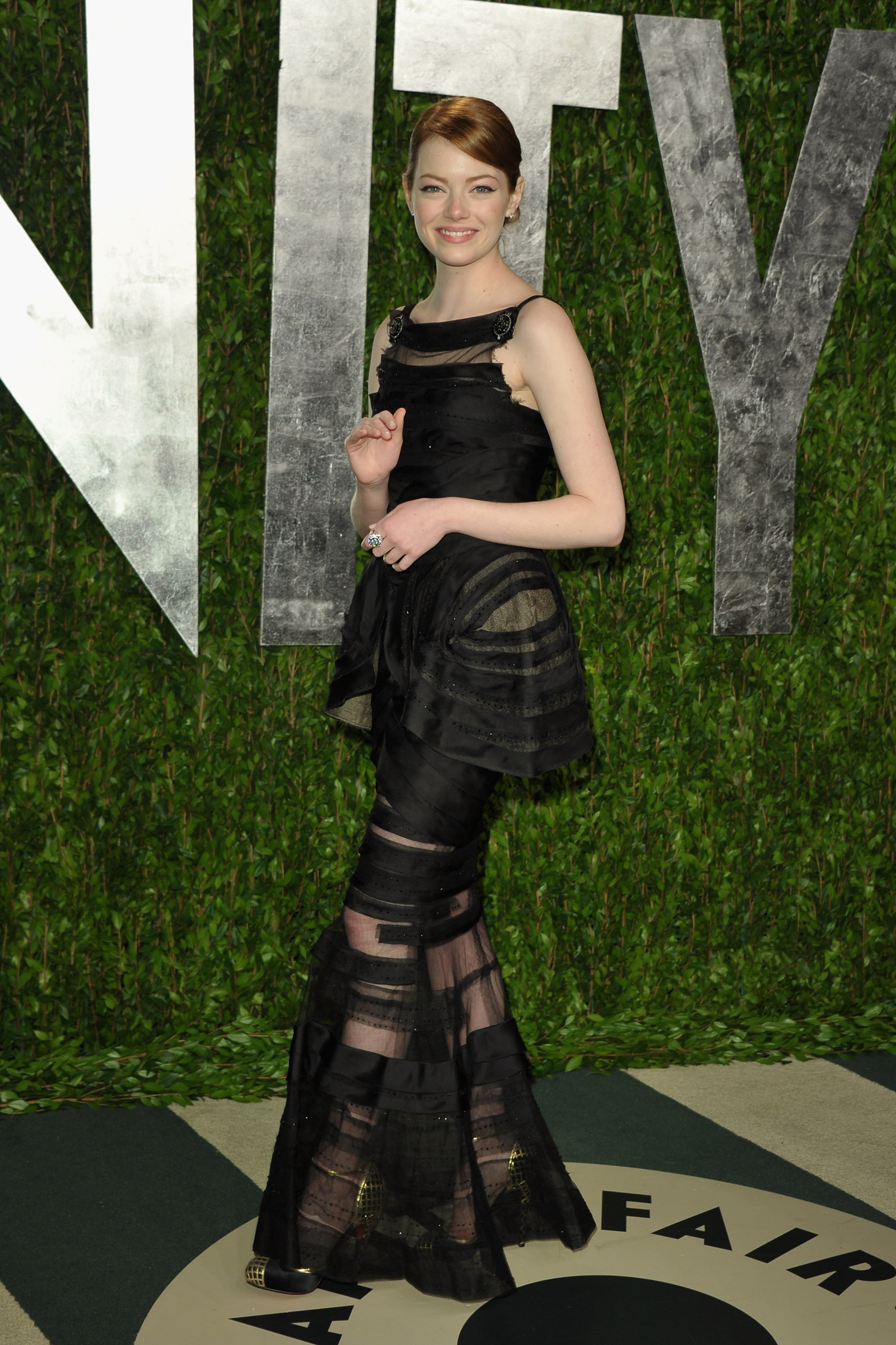 Emma Stone in Chanel at Vanity Fair Oscar afterparty.