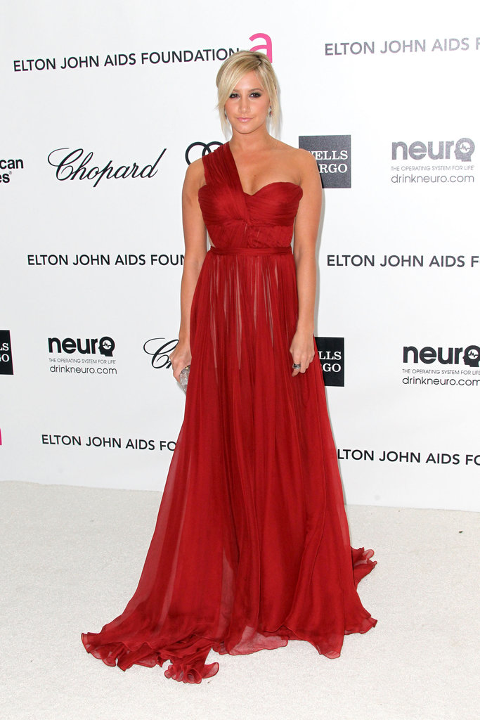 Ashley Tisdale opted for all-out Hollywood glam in a one-shouldered scarlet-red gown by Maria Lucia Hohan dress with Jerome C. Rousseau pumps.
