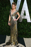 Model Marisa Miller opted for a gold sequined dress with a plunging neckline at the Vanity Fair Oscars party.