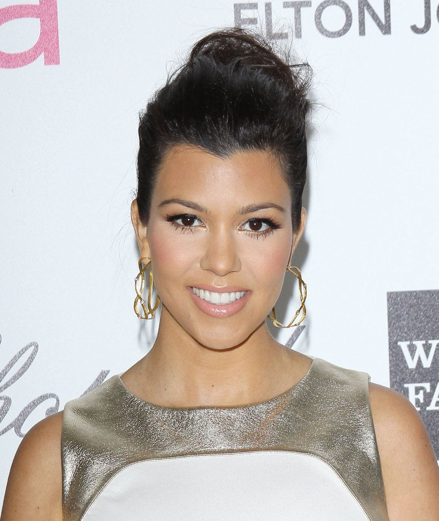 Kourtney Kardashian added a pretty pair of sculpted gold hoops.