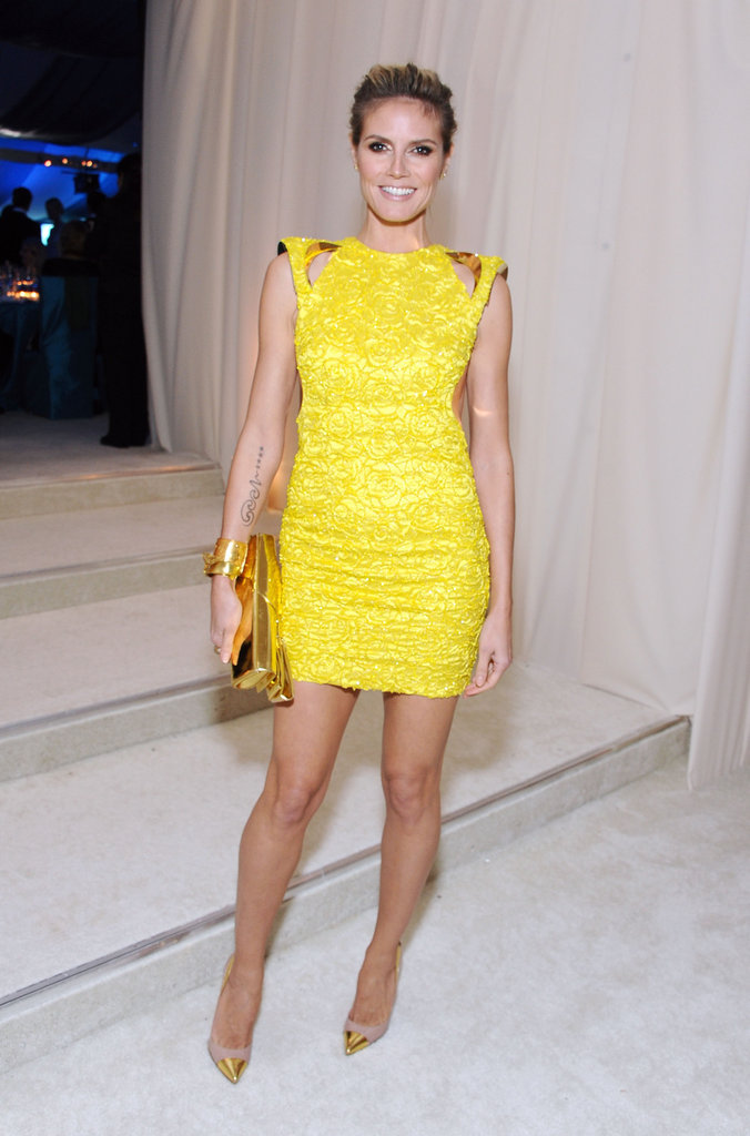 Heidi Klum held nothing back in this neon yellow cutout Versace minidress.