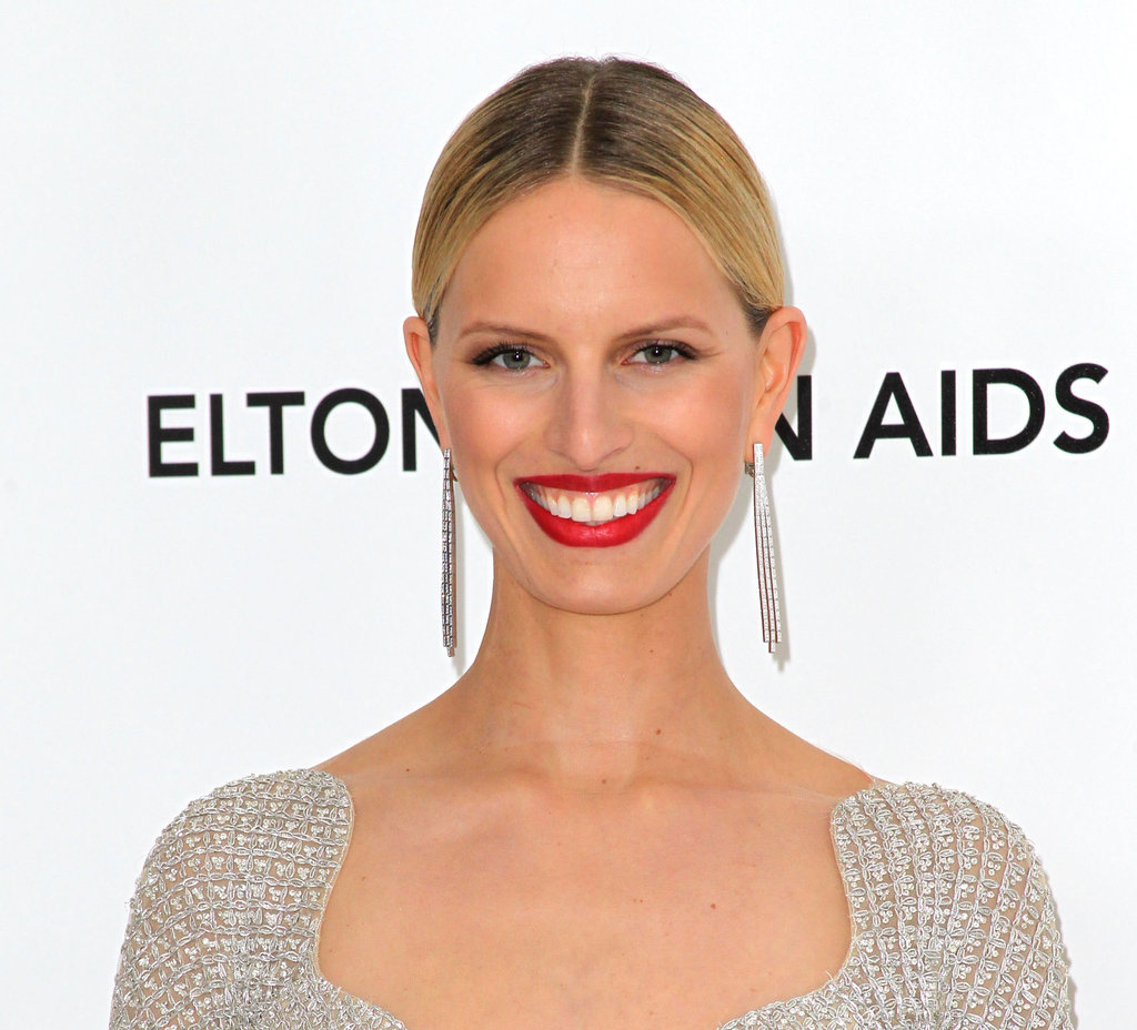 Karolina Kurkova played off the drama of her sparkly Armani jumpsuit with these deco-inspired jewels.