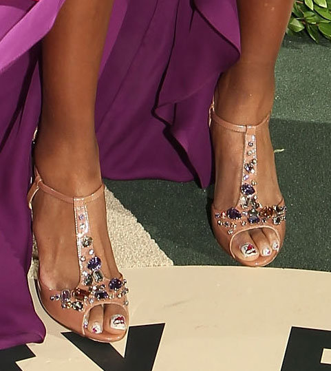 A pair of jewel-adorned nude heels completed Venus's look.