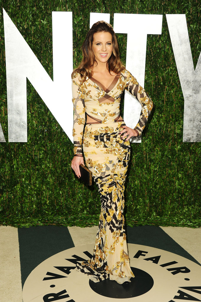 Kate Beckinsale showed off her wild side in a beaded cutout Atelier Versace long-sleeved gown at the Vanity Fair Oscar afterparty.