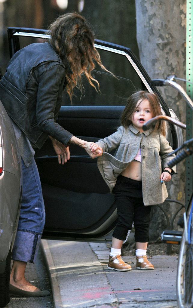 Sarah Jessica Parker helping her daughter, Tabitha Broderick, out of the car on the way to school.