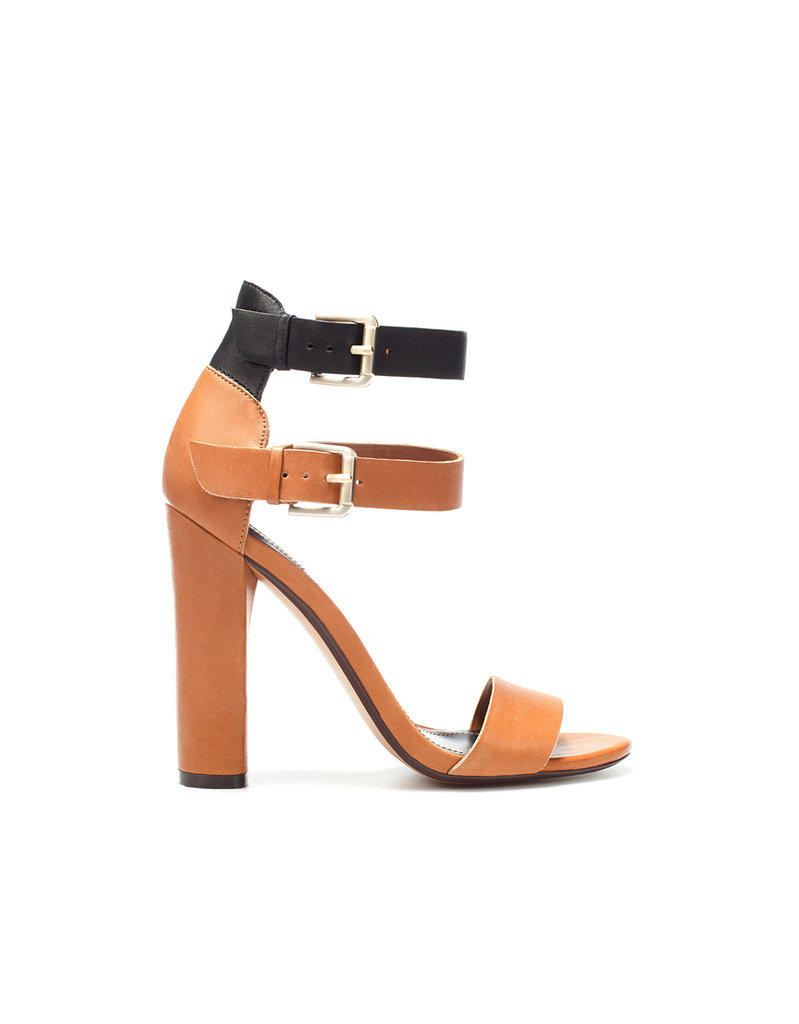 The thick, stacked heel and double buckled strap lend serious support, but really, we're smitten with the sophisticated shape. Zara High Heel Sandal With Buckle ($90)