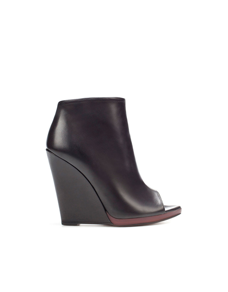 We love the super-streamlined look and the edgy effect these will have paired up with your little dresses and skirts this coming season.  Zara Peep Toe Wedge Ankle Boot ($100)