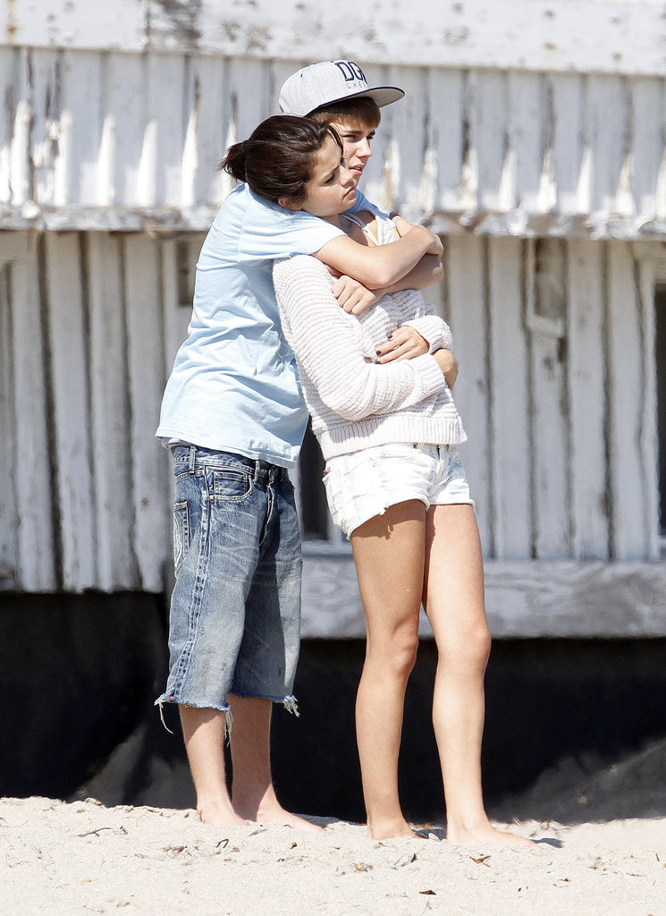 Justin Bieber cuddled with Selena Gomez on the beach in Malibu in September 2011.